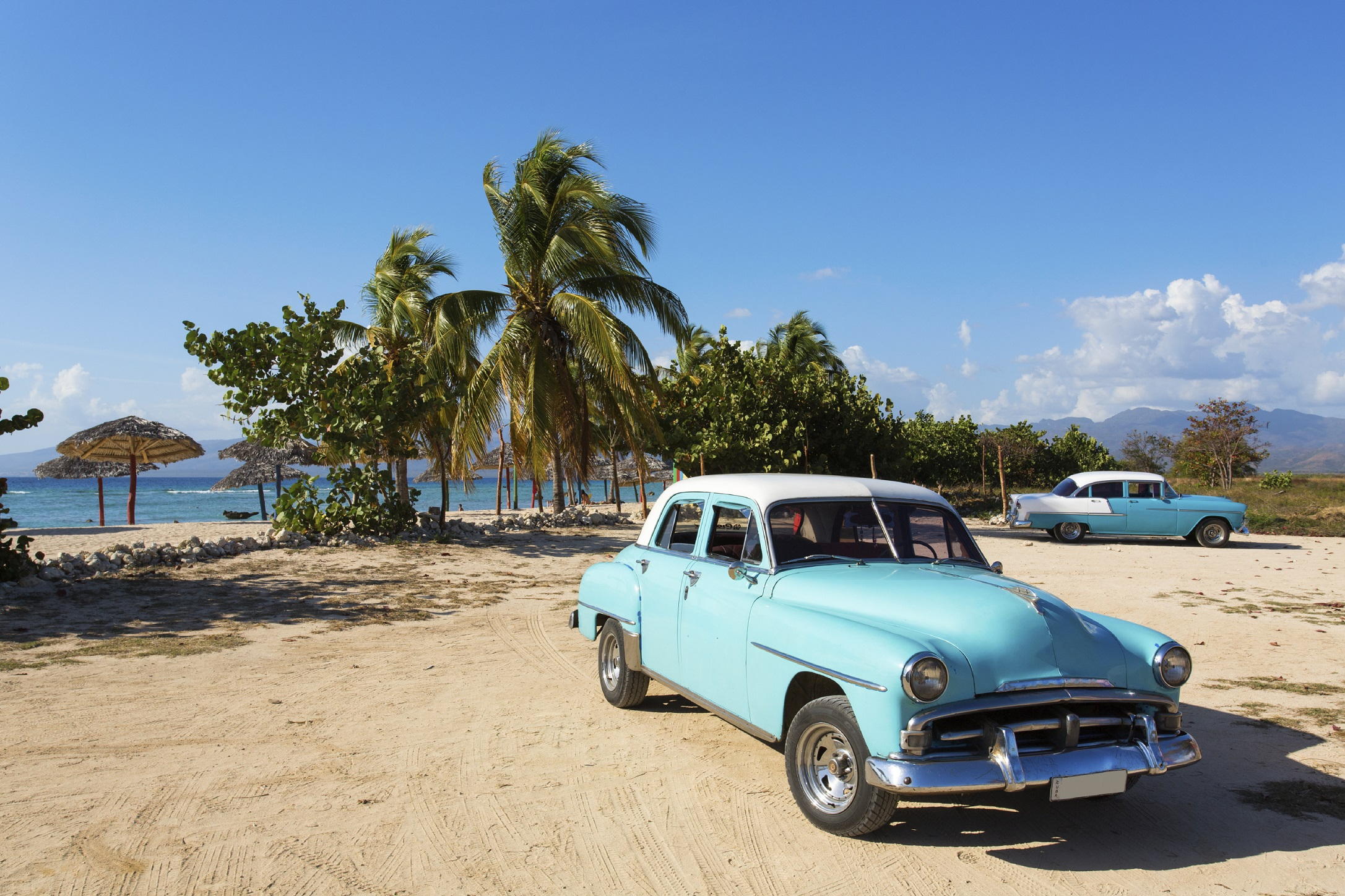 Old classic car on the beach of Cuba