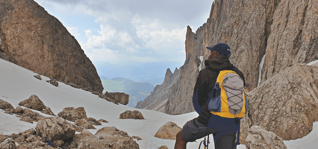 Man standing on Sassolungo in the Dolomites