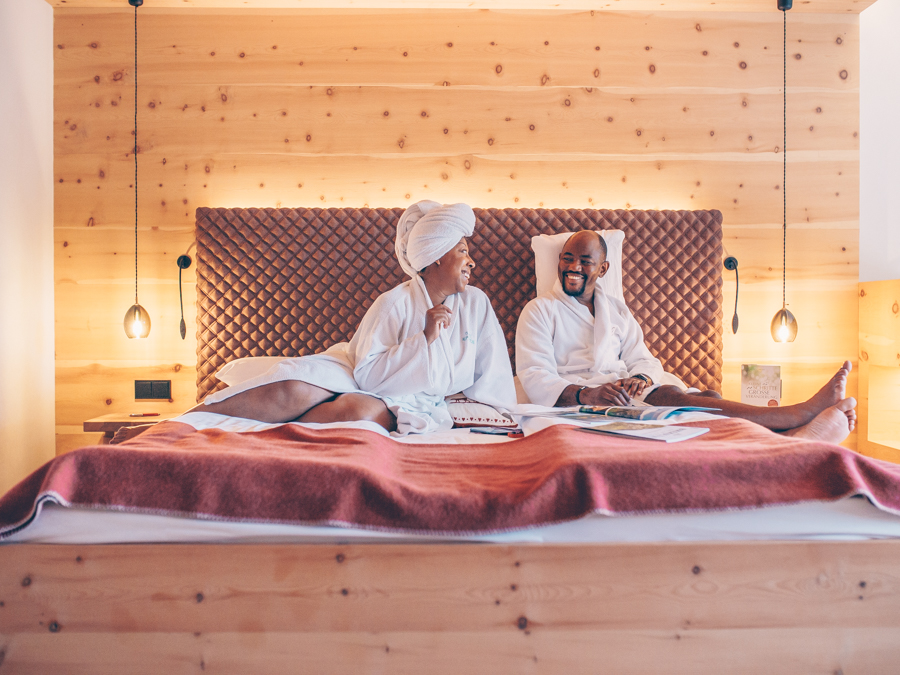 Couple on bed in Natural Room at Bio-Hotel Rupertus Leogang