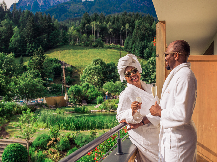 Couple laughing on terrace at Bio-Hotel Rupertus, Leogang, Austria