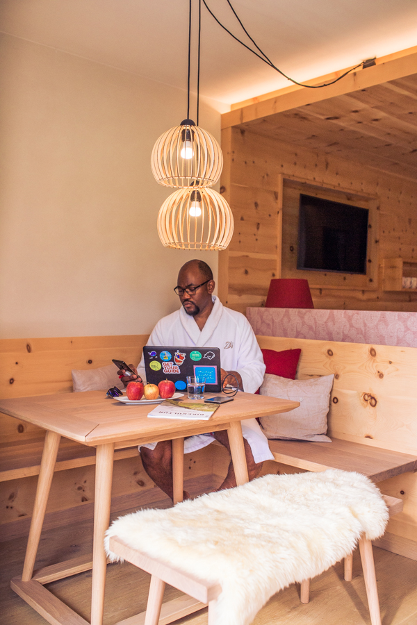 Man working at desk in room at Bio-Hotel Rupertus, Leogang, Austria